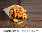 french fries  in a paper bag on ... | Shutterstock . vector #1011710974