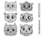 owls. heads. design zentangle.... | Shutterstock .eps vector #1011713761