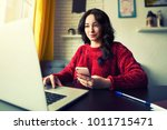 gorgeous female chatting  on... | Shutterstock . vector #1011715471