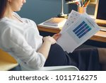 pregnant business woman working ... | Shutterstock . vector #1011716275