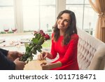 young couple having romantic... | Shutterstock . vector #1011718471