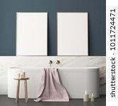 mock up poster in the bathroom... | Shutterstock . vector #1011724471