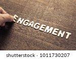 hand arrange wood letters as... | Shutterstock . vector #1011730207