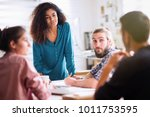 meeting at the office of a... | Shutterstock . vector #1011753595