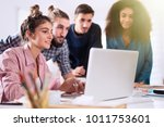 young multiethnic business team ... | Shutterstock . vector #1011753601