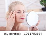 middle aged blond woman... | Shutterstock . vector #1011753994