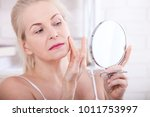 middle aged blond woman... | Shutterstock . vector #1011753997