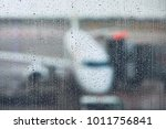 storm at the airport. view of... | Shutterstock . vector #1011756841