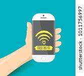 hand holding white smart phone... | Shutterstock .eps vector #1011756997