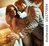 fashionable young couple posing ... | Shutterstock . vector #1011772054