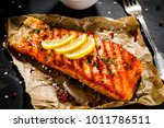 grilled salmon with vegetables... | Shutterstock . vector #1011786511