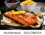grilled salmon with vegetables... | Shutterstock . vector #1011786514