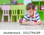 boy kid lay down on floor and...   Shutterstock . vector #1011796189