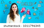 Small photo of Study English theme with young woman holding flags
