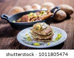 fried stacked potato cakes on... | Shutterstock . vector #1011805474