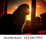 scottish sun silhouette  | Shutterstock . vector #1011827995