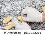 hands cooking ravioli pasta... | Shutterstock . vector #1011832291