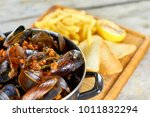 close up saucepan with shell... | Shutterstock . vector #1011832294
