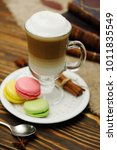 latte and macaroons close up on ... | Shutterstock . vector #1011835549