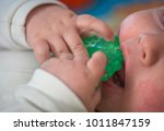 teething  the first tooth in a... | Shutterstock . vector #1011847159
