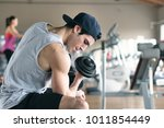 a guy  wearing a tank top in a... | Shutterstock . vector #1011854449