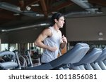 a guy in the gym to stay fit... | Shutterstock . vector #1011856081