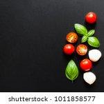 fresh cherry tomatoes  basil...   Shutterstock . vector #1011858577