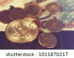 bitcoin on euro coins   Shutterstock . vector #1011870217