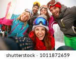 group of smiling friends making ... | Shutterstock . vector #1011872659
