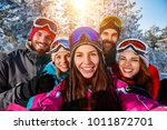 happy freinds taking photo with ... | Shutterstock . vector #1011872701