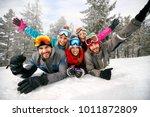 smiling friends on winter... | Shutterstock . vector #1011872809