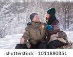 smiling man and woman sitting... | Shutterstock . vector #1011880351