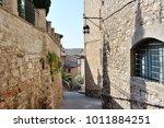 medieval street in the italian...   Shutterstock . vector #1011884251