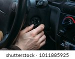 closeup of male driver hand... | Shutterstock . vector #1011885925