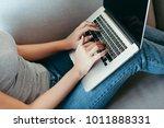 closeup hands on laptop | Shutterstock . vector #1011888331