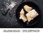 parmesan cheese on black... | Shutterstock . vector #1011895624