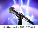 microphone with stage lighting... | Shutterstock . vector #1011895645