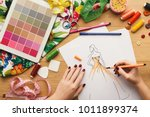 top view on fashion designer at ... | Shutterstock . vector #1011899374