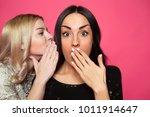 gossip. close up prtrait of two ... | Shutterstock . vector #1011914647