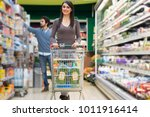 young woman shopping in a... | Shutterstock . vector #1011916414