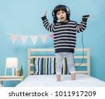 cute little girl sing a song...   Shutterstock . vector #1011917209