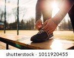 male athlete doing stretching...   Shutterstock . vector #1011920455