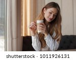 beautiful woman in a cafe... | Shutterstock . vector #1011926131
