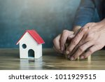 businessman with model house... | Shutterstock . vector #1011929515