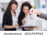 salesman carrying a model house ...   Shutterstock . vector #1011929965