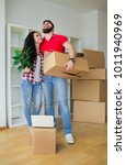 young couple unpacking...   Shutterstock . vector #1011940969