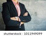 businesswoman cross one's arm... | Shutterstock . vector #1011949099