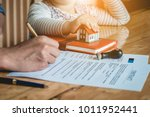 parent signing at contract... | Shutterstock . vector #1011952441