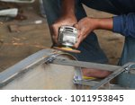 worker sawing metal with a... | Shutterstock . vector #1011953845