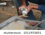 worker sawing metal with a... | Shutterstock . vector #1011953851